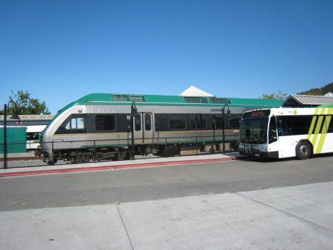 A SMART train passes a Marin Transit bus at the San Rafael Transit Center on Tuesday, July 13, 2021.