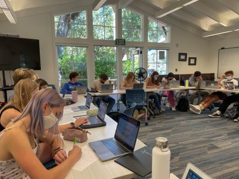 Seniors take a class in the Writing Center in September. The Immersive program, new for the 2021-22 school year, will replace senior capstone projects.
